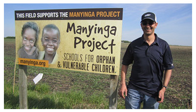 Dr. Abdel El Hadrami at Art Enns's Manyinga Project-supporting canola field
